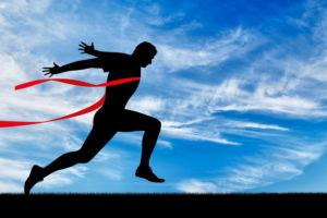 Running sports. Man runner and red tape
